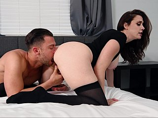 MILF in black rides a younger cock